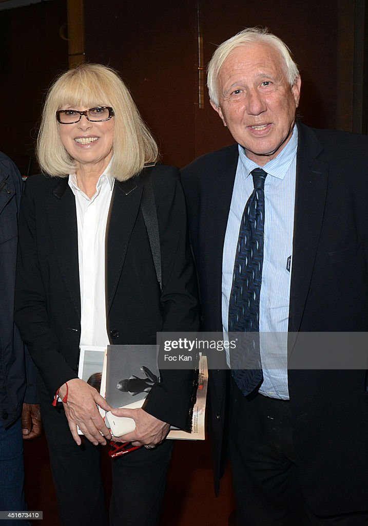 <a gi-track='captionPersonalityLinkClicked' href=/galleries/search?phrase=Mireille+Darc&family=editorial&specificpeople=1512607 ng-click='$event.stopPropagation()'>Mireille Darc</a> and Dr. Alain Deloche attend 'Les CÏurs des Createurs' Auction Cocktail in profit of 'La Chaine de L'Espoir' Association at Christie's on July 3, 2014 in Paris, France.