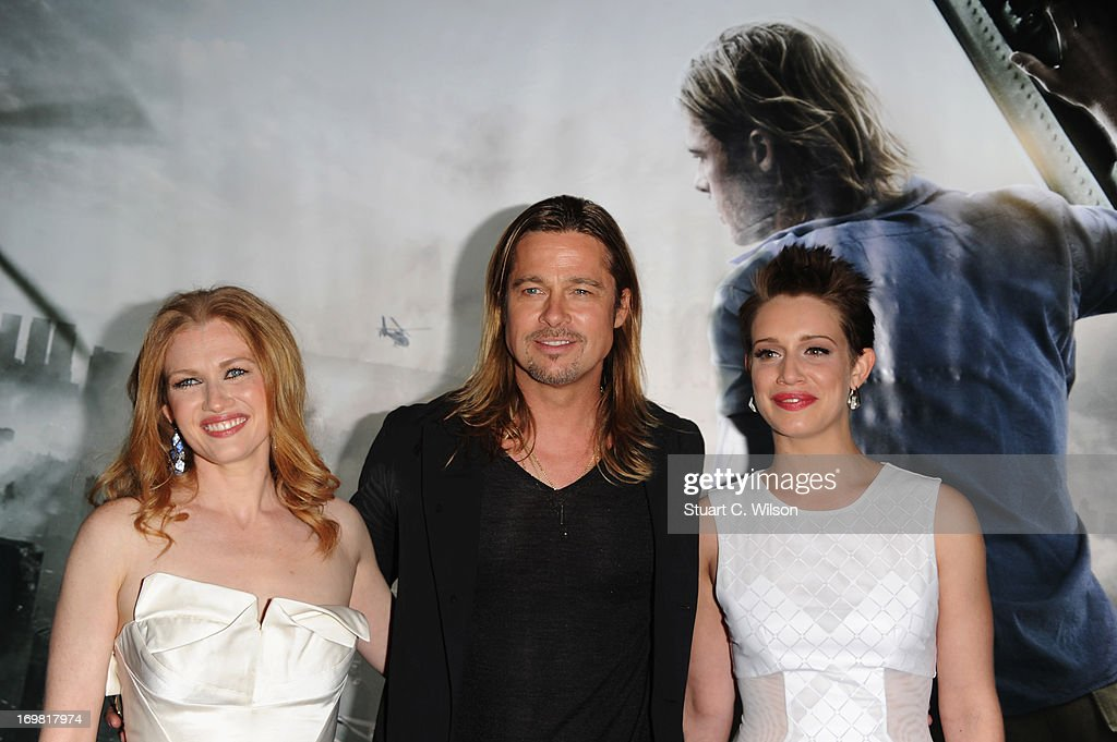 <a gi-track='captionPersonalityLinkClicked' href=/galleries/search?phrase=Mireille+Enos&family=editorial&specificpeople=784800 ng-click='$event.stopPropagation()'>Mireille Enos</a>, <a gi-track='captionPersonalityLinkClicked' href=/galleries/search?phrase=Brad+Pitt&family=editorial&specificpeople=201682 ng-click='$event.stopPropagation()'>Brad Pitt</a> and Daniella Kertesz attend the World Premiere of 'World War Z' at The Empire Cinema on June 2, 2013 in London, England.