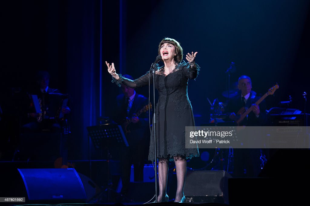 <a gi-track='captionPersonalityLinkClicked' href=/galleries/search?phrase=Mireille+Mathieu&family=editorial&specificpeople=738659 ng-click='$event.stopPropagation()'>Mireille Mathieu</a> performs at L'Olympia on October 24, 2014 in Paris, France.