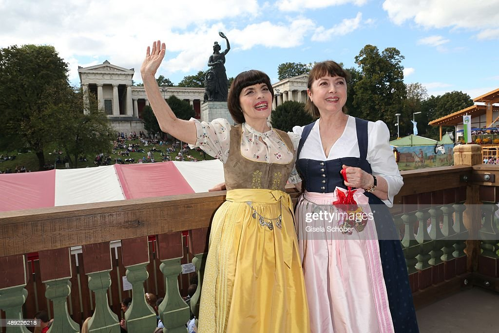 <a gi-track='captionPersonalityLinkClicked' href=/galleries/search?phrase=Mireille+Mathieu&family=editorial&specificpeople=738659 ng-click='$event.stopPropagation()'>Mireille Mathieu</a>, wearing a dirndl by Daniel Fendler, and sister <a gi-track='captionPersonalityLinkClicked' href=/galleries/search?phrase=Monique+Mathieu&family=editorial&specificpeople=7739282 ng-click='$event.stopPropagation()'>Monique Mathieu</a> during the Oktoberfest 2015 Opening at Kaeferschaenke beer tent at Theresienwiese on September 19, 2015 in Munich, Germany.