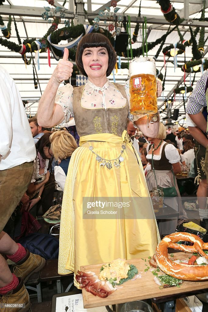 <a gi-track='captionPersonalityLinkClicked' href=/galleries/search?phrase=Mireille+Mathieu&family=editorial&specificpeople=738659 ng-click='$event.stopPropagation()'>Mireille Mathieu</a> wearing a dirndl by Daniel Fendler during the Oktoberfest 2015 Opening at Schottenhamel beer tent at Theresienwiese on September 19, 2015 in Munich, Germany.