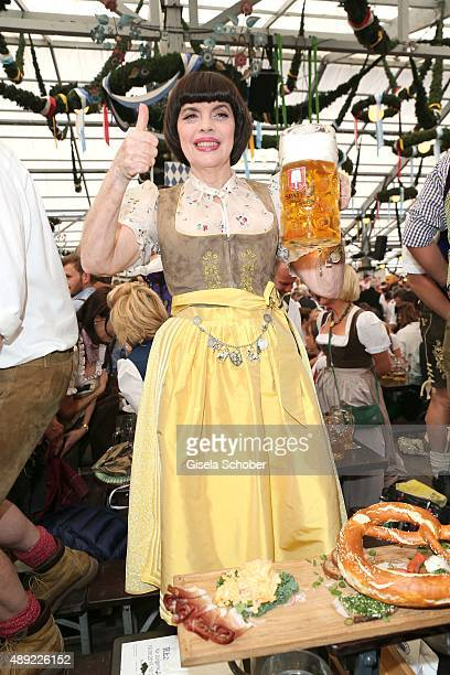 Mireille Mathieu wearing a dirndl by Daniel Fendler during the Oktoberfest 2015 Opening at Schottenhamel beer tent at Theresienwiese on September 19...