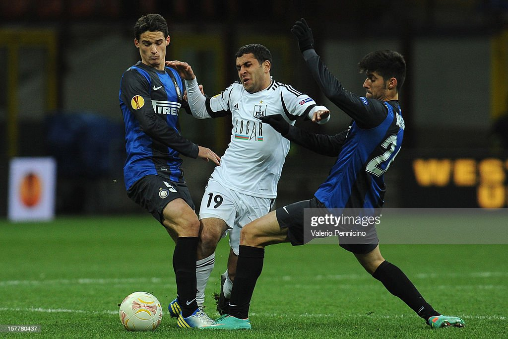 Mirhüseyin Seyidov (C) of Neftci PFK is challenged by Andrea Romano (L) and Marco Benassi (R) of FC Internazionale Milano during the UEFA Europa League group H match between FC Internazionale Milano and Neftci PFK on December 6, 2012 in Milan, Italy.