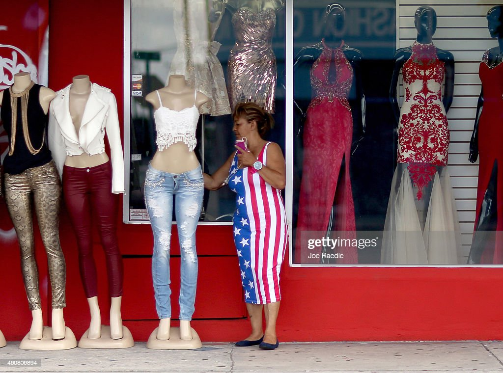 Miriam Belarde looks at clothes for sale as reports indicate that the 3rd quarter GDP was 50% revised up from last month's estimate of 39% and a...
