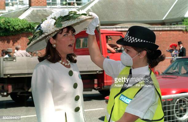 Miriam Francombe is given a helping hand by WPC Sarah Cameron from Reading Police Station on the first day of Royal Ascot Week