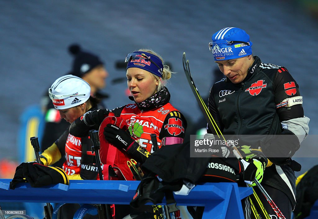 Miriam Goennser (L) of Germany talks to team mate Andreas Birnbacher during an offical training session at Vysocina Arena on February 6, 2013 in Nove Mesto na Morave, Czech Republic.