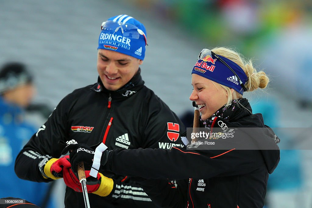 Miriam Goennser (R) of Germany talks to team mate Simon Schempp during an offical training session at Vysocina Arena on February 6, 2013 in Nove Mesto na Morave, Czech Republic.