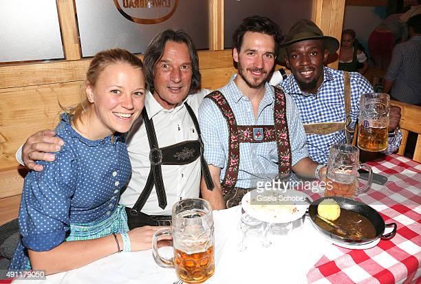 Miriam Goessner Dr HansWilhelm MuellerWohlfahrt skier Felix Neureuther and sprinter and olympic champion Usain Bolt during the Oktoberfest 2015 at...