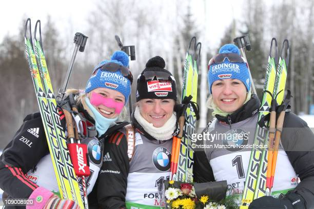 Miriam Goessner of Germany celebrates with todays winner Andrea Henkel of Germany and Magdalena Neuner of Germany after the women's sprint during the...