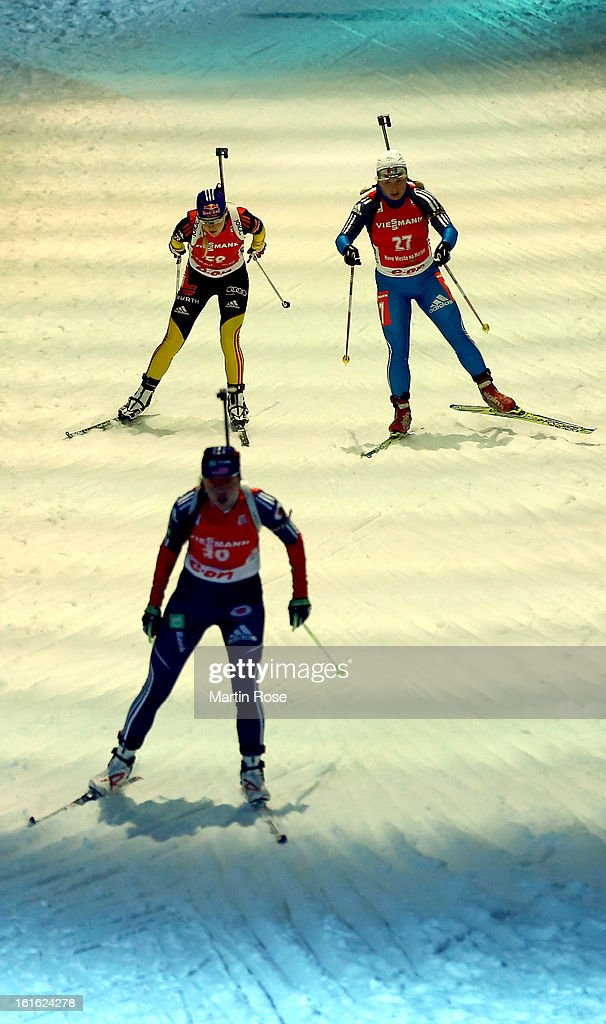 Miriam Goessner (L) of Germany competes in the Women's 15km Individual during the IBU Biathlon World Championships at Vysocina Arena on February 13, 2013 in Nove Mesto na Morave, Czech Republic.