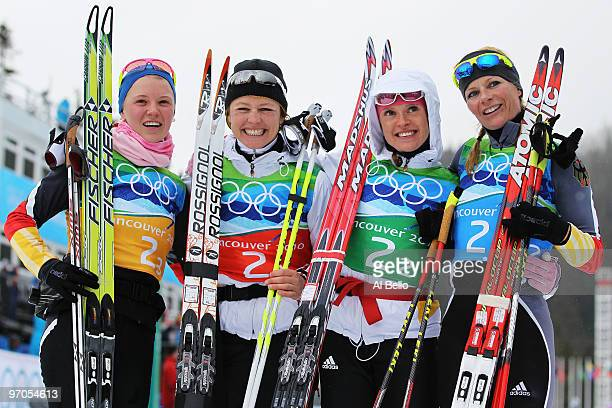 Miriam Gossner Katrin Zeller Evi SachenbacherStehle and Claudia Nystad of Germany celebrate winning the silver medal during the Ladies' Cross Country...