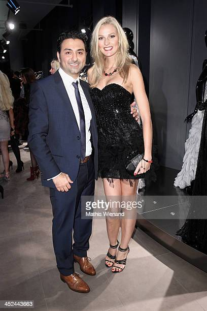 Miriam Hoeller and Shahin Moghadam attend the Unique Flagship Store Opening at the new 'Koe Bogen' on November 28 2013 in Duesseldorf Germany
