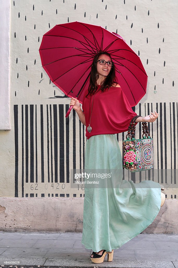 Miriam is wearing a Jose Rivero blouse and skirt Coral Rivero jewelry Klu handbag Bisetti umbrellas Tous eyeglasses and Mari Paz shoes on August 19...