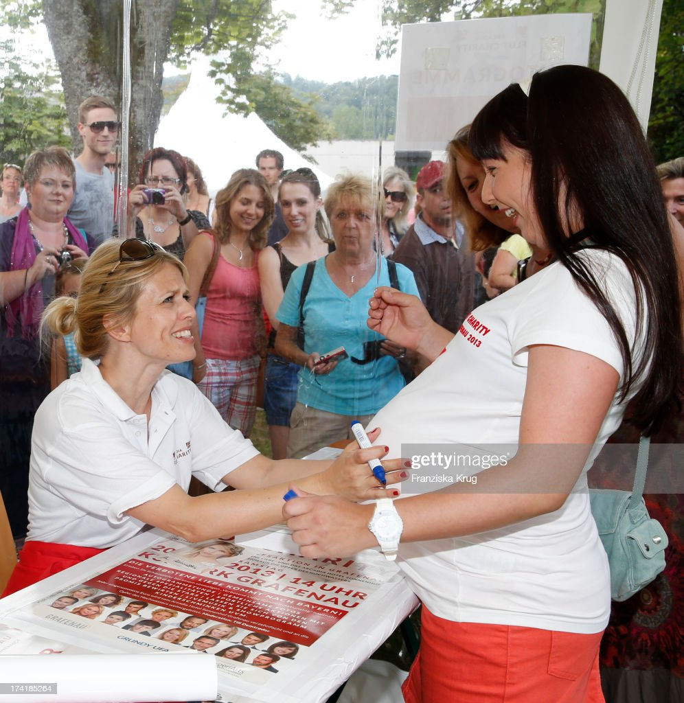 Miriam Lahnstein and fan attend the Charity Event Benefitting Flood Victims on July 20, 2013 in Grafenau, Germany.