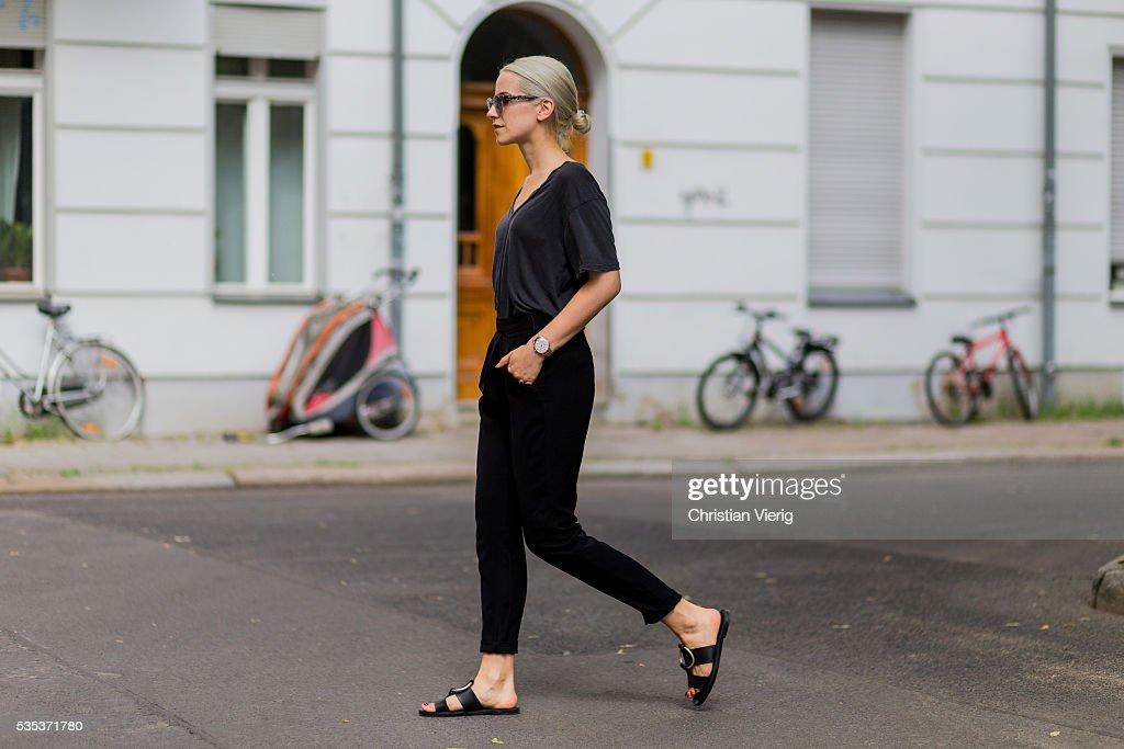 Miriam Mache wearing black Reserved pants, VIU Eyewear sunglasses, a grey Zara shirt, a Henry London watch, black sandals from Mango on May 29, 2016 in Berlin, Germany.