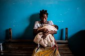 Miriam Thomas an Hiv positive patient on antiretroviral therapy holds her second baby as she waits for a medical consultation at the Nsanje District...