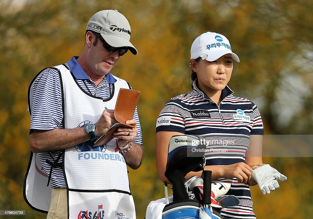 Mirim Lee (R) of South Korea prepares to hit a tee shot on the fourth hole during the first round of the JTBC LPGA Founders Cup at Wildfire Golf Club on March 20, 2014 in Phoenix, Arizona.