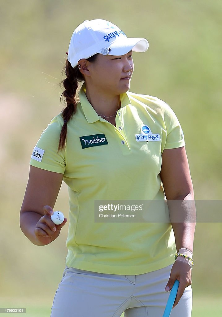 Mirim Lee of South Korea reacts to fans after a birdie putt on the 18th green to complete the second round of the JTBC LPGA Founders Cup at Wildfire Golf Club on March 21, 2014 in Phoenix, Arizona.