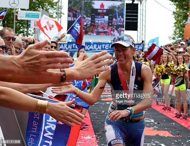 Mirinda Carfrae of Australia celebrates winning the women's race of Ironman Austria on June 26 2016 in Klagenfurt Austria