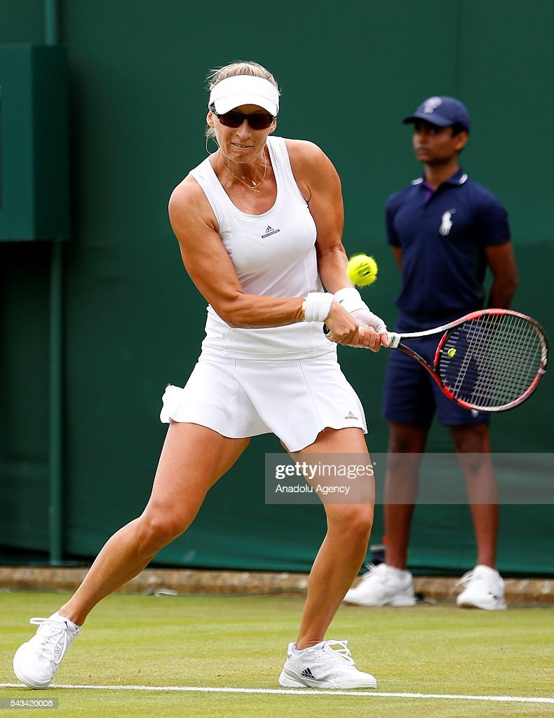 Mirjana Lucic-Baroni (C) of Croatia in action against Dominika Cibulkova of Slovakia (not seen) during the Women's Singles on day two of the 2016 Wimbledon Championships at the All England Lawn and Croquet Club in London, United Kingdom on June 28, 2016.