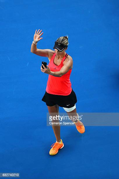 Mirjana LucicBaroni of Croatia takes photos with her phone after losing her semifinal match against Serena Williams of the United States on day 11 of...