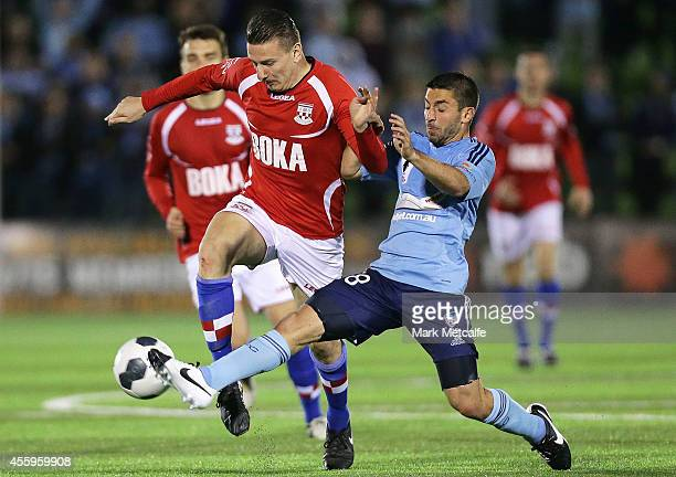 Mirjian Pavlovic of United is tackled by Peter Triantis of Sydney during the FFA Cup match between Sydney United 58 FC and Sydney FC at Edensor Park...