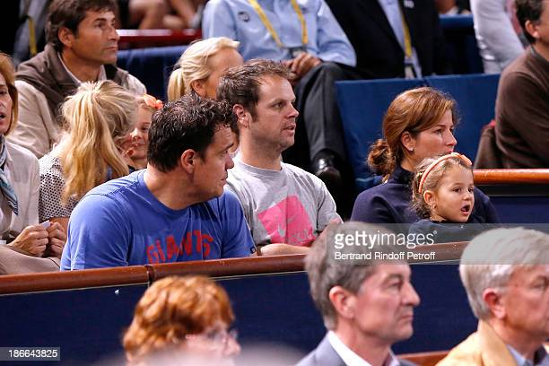 Mirka Federer and her daughter watch her husband Roger Federer play during day six of the BNP Paribas Tennis Masters held at Bercy on November 2 2013...