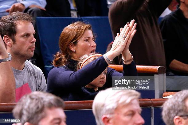 Mirka Federer and her daughter watch her husband Roger Federer plays during day six of the BNP Paribas Tennis Masters held at Bercy on November 2...