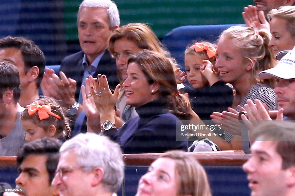 Mirka Federer (C) and her daughters (R and L) watch her husband Roger Federer plays during day six of the BNP Paribas Tennis Masters, held at Bercy on November 2, 2013 in Paris, France.
