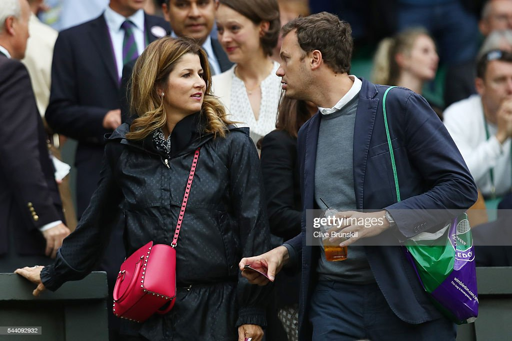 Mirka Federer in conversation as she watches her husband Roger Federer of Switzerland face Daniel Evans of Great Britain in the Men's Singles third round match on day five of the Wimbledon Lawn Tennis Championships at the All England Lawn Tennis and Croquet Club on July 1, 2016 in London, England.