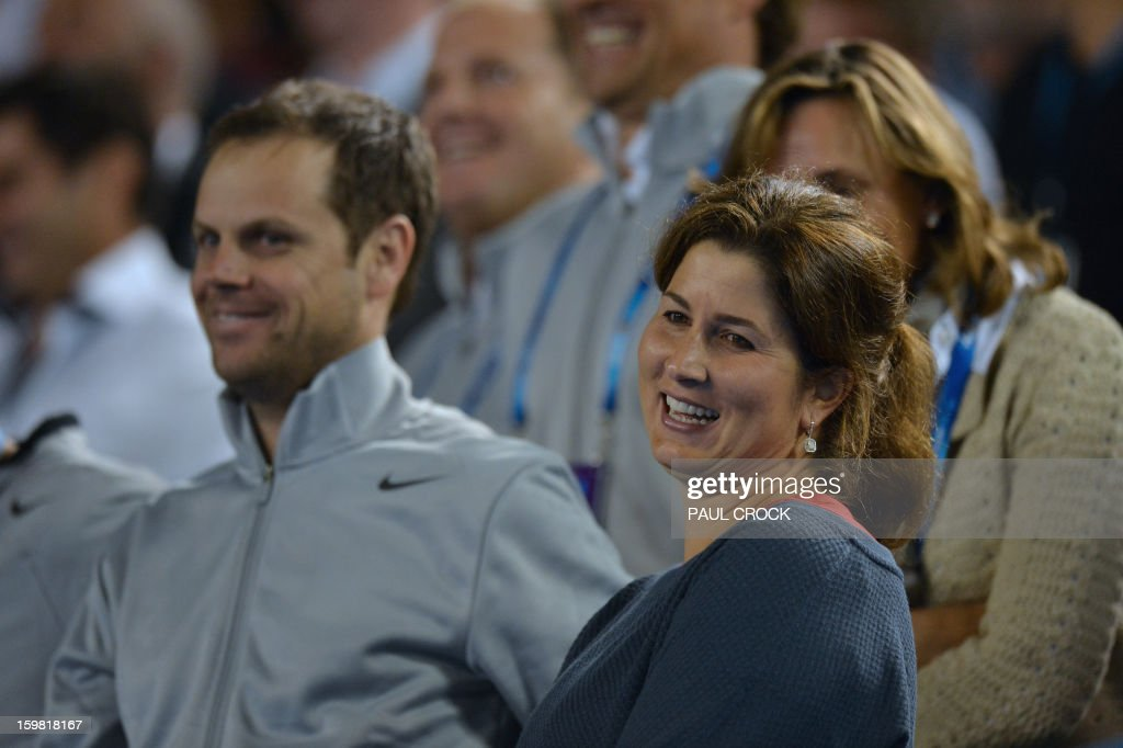 Mirka Federer (R) , the wife of Switzerland's Roger Federer looks on from the stands after his victory in his men's singles match against Canada's Milos Raonic on the eighth day of the Australian Open tennis tournament in Melbourne on January 21, 2013.