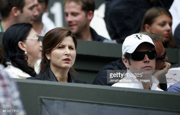 Mirka Federer watches her husband Switzerland's Roger Federer in his match against Ukraine's Sergiy Stakhovsky during day Three of the Wimbledon...