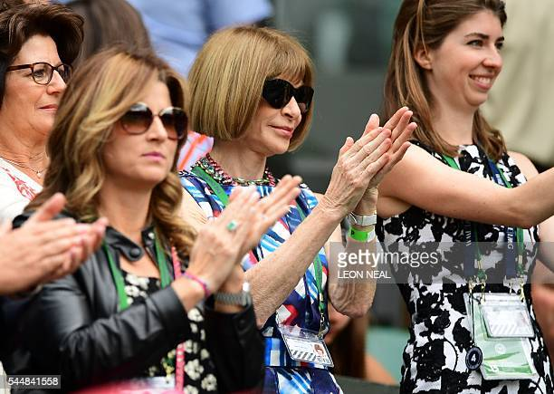 Mirka Federer wife of Roger Federer and US Vogue editor Anna Wintour clap on centre court on the eighth day of the 2016 Wimbledon Championships at...