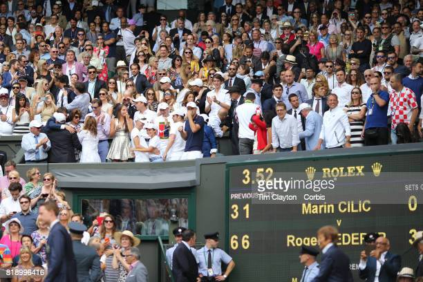 Mirka Federer wife of Roger Federer celebrates with family and staff in their box after Roger Federer's win in the Gentlemen's Singles final during...