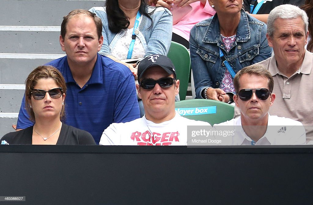 Mirka Federer, wife of Roger Federer of Switzerland and his coach Stefan Edberg watch him in his third round match against Teymuraz Gabashvili of Russia during day six of the 2014 Australian Open at Melbourne Park on January 18, 2014 in Melbourne, Australia.