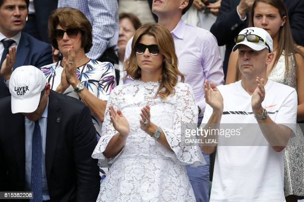 Mirka Federer wife of Switzerland's Roger Federer applauds after her husband won a point against Croatia's Marin Cilic during their men's singles...