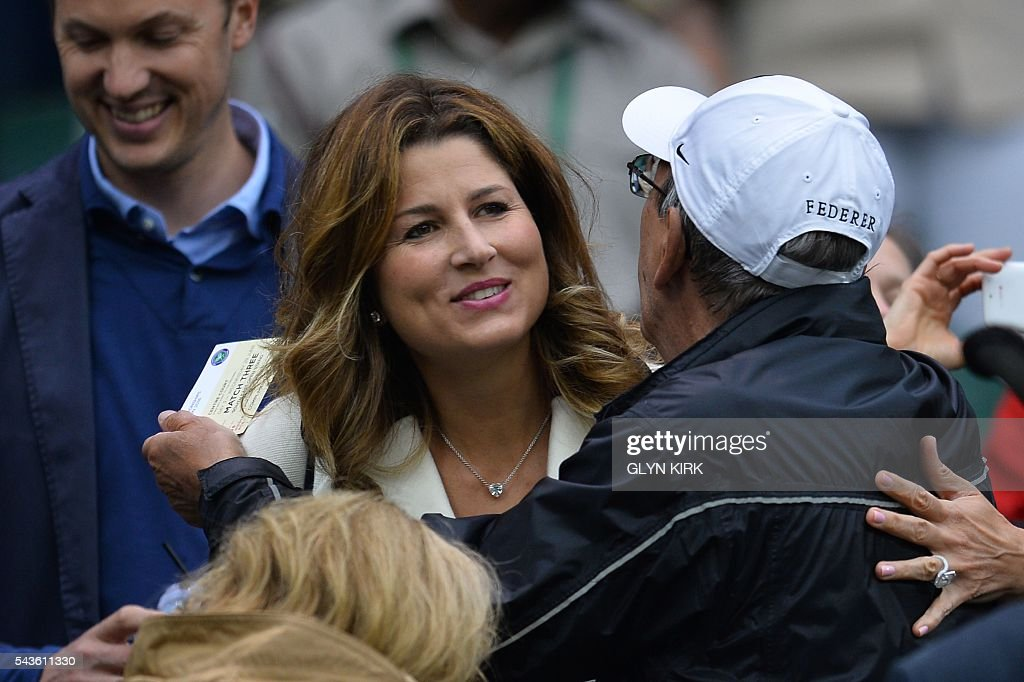 Mirka Federer, wife of Switzerland's Roger Federer, arrives to take her seat in the royal box on centre court to watch Marcus Willis play against Switzerland's Roger Federer during their men's singles second round match on the third day of the 2016 Wimbledon Championships at The All England Lawn Tennis Club in Wimbledon, southwest London, on June 29, 2016. / AFP / GLYN