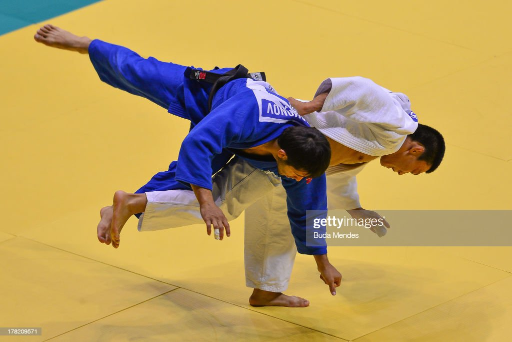 Mirkahid Farmonov (blue) of Uzbekistan fights against Sergey Lim of Kazakhstan in the 66 kg category during the World Judo Championships at Gymnasium Maracanazinho on August 27, 2013 in Rio de Janeiro, Brazil.