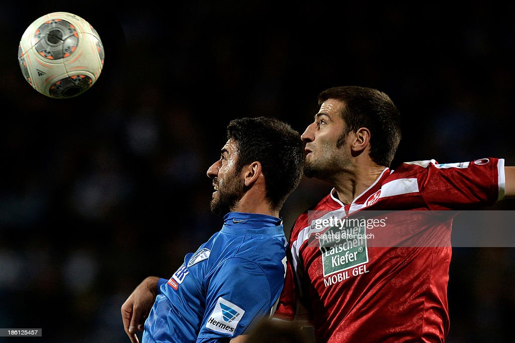 Mirkan Aydin of Bochum and Markus Karl of Kaiserslautern battle for a header during the Second Bundesliga match between VfL Bochum and 1. FC Kaiserslautern at Rewirpower Stadion on October 28, 2013 in Bochum, Germany.