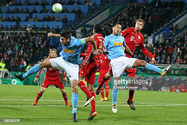 Mirkan Aydin of Bochum Luiz Gustavo of Bayern Chong Tese of Bochum and Holger Badstuber of Bayern go up for a header during the DFB Cup round of...