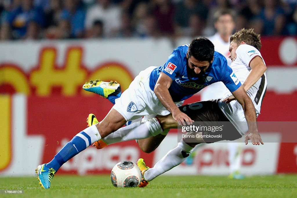 Mirkan Aydin of VfL Bochum and Christopher Buchtmann of St Pauli battle for the ball during the Second Bundesliga match between VfL Bochum and FC St...