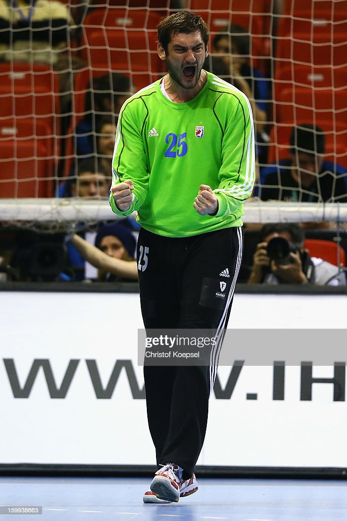 Mirko Alilovic of Croatia celebrates saving a seven meter shot during the quarterfinal match between France and Croatia at Pabellon Principe Felipe Arena on January 23, 2013 in Barcelona, Spain.