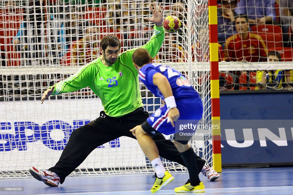Mirko Alilovic of Croatia saves a seven meter shot of Michael Guigou of France during the quarterfinal match between France and Croatia at Pabellon Principe Felipe Arena on January 23, 2013 in Barcelona, Spain.