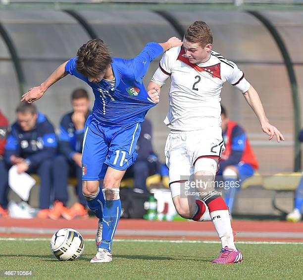 Mirko Antonucci of Italy and Julian Schwermann of Germany in action during the international friendly match between U16 Italy and U16 Germany on...
