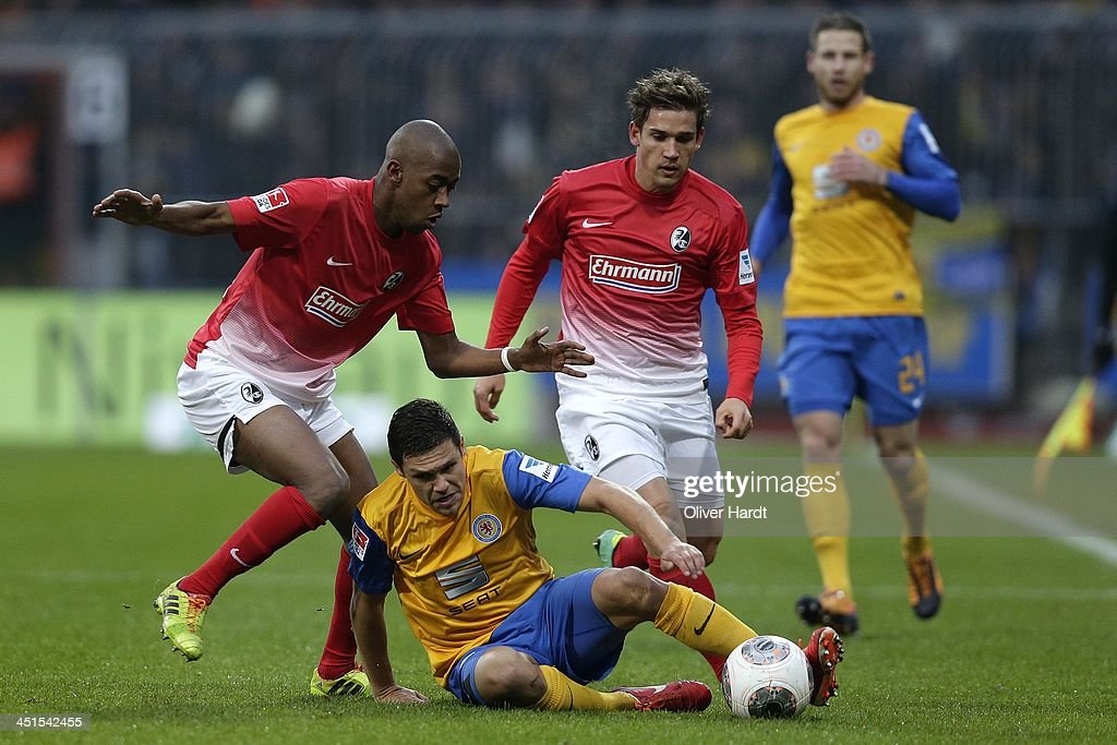 Mirko Boland (C) of Braunschweig and <a gi-track='captionPersonalityLinkClicked' href=/galleries/search?phrase=Gelson+Fernandes&family=editorial&specificpeople=2971817 ng-click='$event.stopPropagation()'>Gelson Fernandes</a> (L) of Freiburg compete for the ball during the Bundesliga match between Eintracht Braunschweig and SC Freiburg at Eintracht Stadion on November 23, 2013 in Braunschweig, Germany.