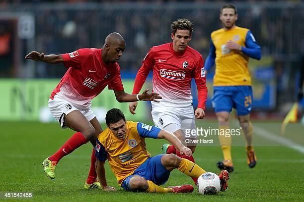 Mirko Boland of Braunschweig and Gelson Fernandes of Freiburg compete for the ball during the Bundesliga match between Eintracht Braunschweig and SC...