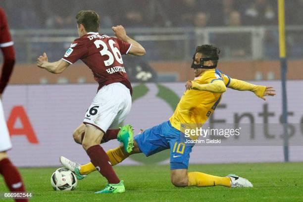 Mirko Boland of Braunschweig challenges Niklas Hauptmann of Dresden during the Second Bundesliga match between Eintracht Braunschweig and SG Dynamo...
