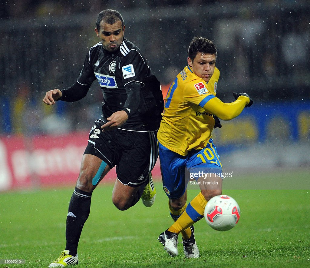 Mirko Boland of Braunschweig is challenged by Cidimar of Aalen during the second Bundesliga match between Eintracht Braunschweig and VfR Aalen at Eintracht Stadion on February 8, 2013 in Braunschweig, Germany.