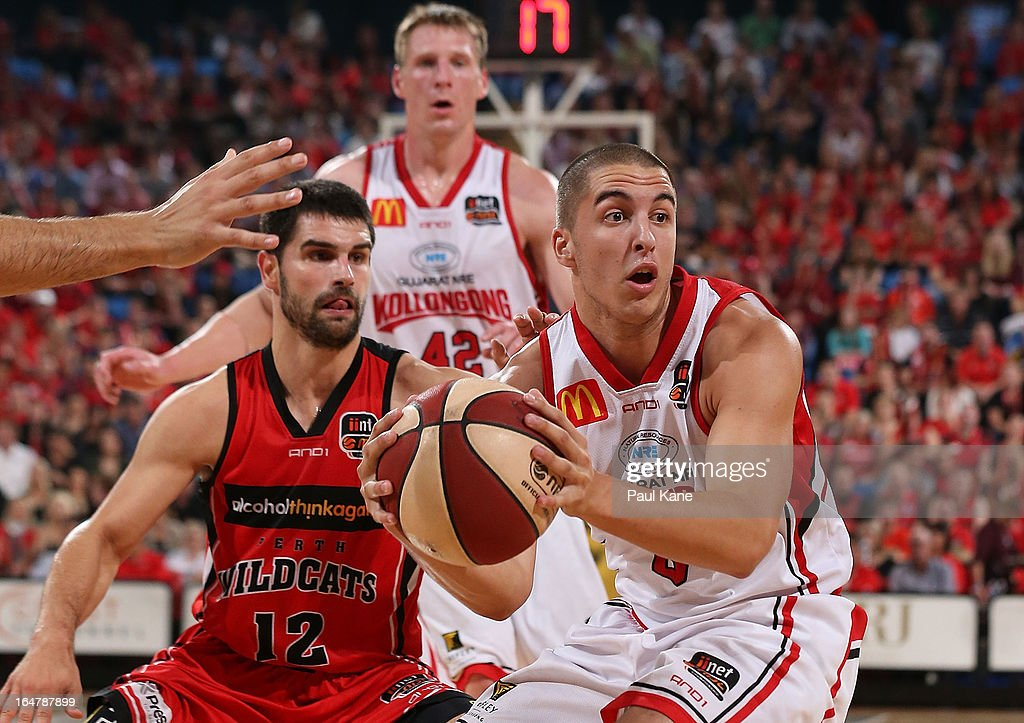 Mirko Djeric of the Hawks looks to pass the ball during game one of the NBL Semi Final Series between the Perth Wildcats and the Wollongong Hawks at Perth Arena on March 28, 2013 in Perth, Australia.
