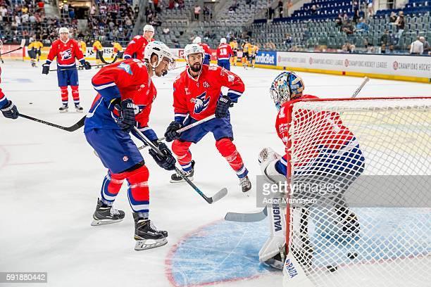 Mirko Hoefflin of Adler Dominik Bittner of Adler and Florian Proske of Adler warm up during the Champions Hockey League match between Adler Mannheim...